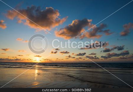 Sunset on the sea stock photo, Sunset on the sea with beautiful clouds on blue sky by Iryna Rasko