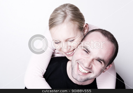 Embrace. stock photo, Happy couple - focus on the girl. by Piotr Skubisz