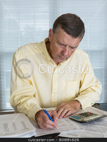 Senior man preparing USA tax form 1040 for 2012 stock photo, Senior caucasian man preparing tax form 1040 for tax year 2012  with receipts and calculator by Steven Heap