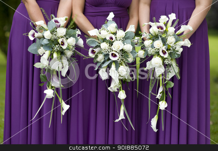 three bridesmaids holding wedding bouquets stock photo, three bridesmaids in purple dresses holding wedding bouquets by Lee Avison