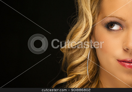 Blonde Model Headshot stock photo, Parcel view of a blonde female model in a studio environment against a black background by Walter Arce