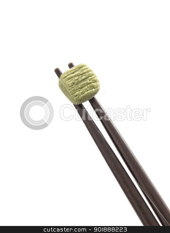 wasabi stock photo, close up of wasabi pellet on chopsticks by zkruger