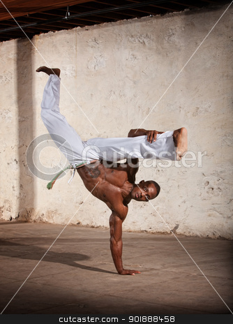 Agile African Martial Artist Kicking stock photo, Strong African man demonstrating a Capoeria one armed kick by Scott Griessel