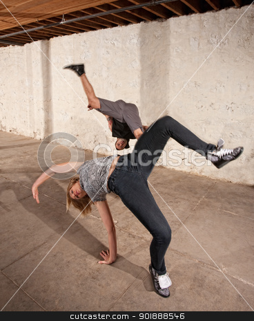 Capoeria Aerial Cartwheels stock photo, Capoeria martial artists performing aerial cartwheels by Scott Griessel