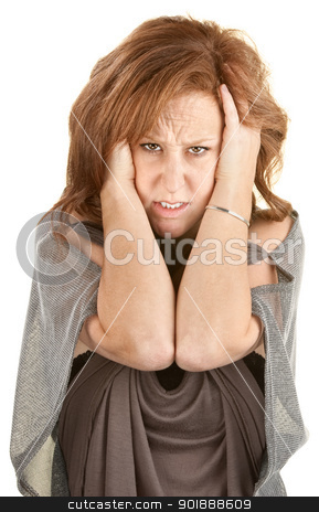 Angry Woman Holding Her Head stock photo, Distressed young woman over white background holding her head by Scott Griessel