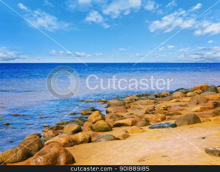 Sea rocky beach stock photo, Sea rocky beach in sunny day, blue cloudy sky  by Sergej Razvodovskij