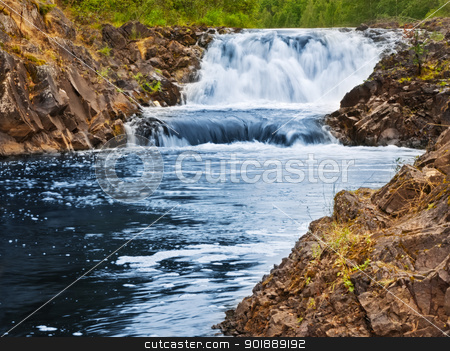 waterfall stock photo, waterfall between rocks in forest scenery  by Sergej Razvodovskij