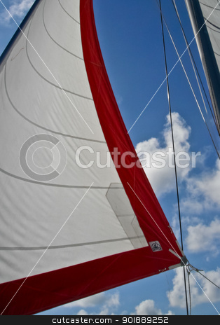 Sailing stock photo, Set sails against a beautiful blue sky by Katie Smith