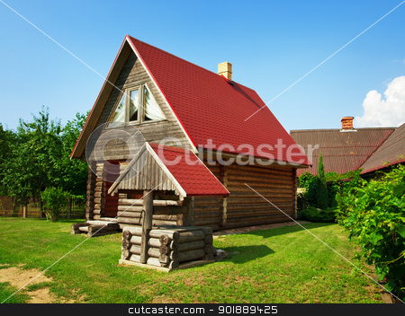 wooden house and well in the yard stock photo, wooden village house with well in the yard by Sergej Razvodovskij