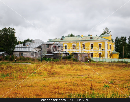 buildings stock photo, Several residential buildings. One of them is in poor condition by Sergej Razvodovskij