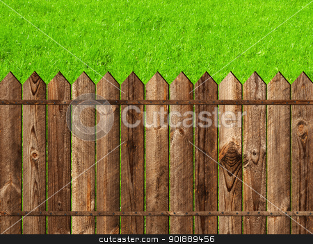 wooden fence stock photo, wooden fence against the green grass by Sergej Razvodovskij