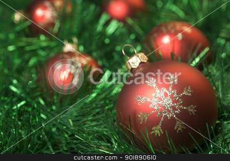 Christmas balls. stock photo, Red christmas balls on the green tinsel. by Piotr Skubisz