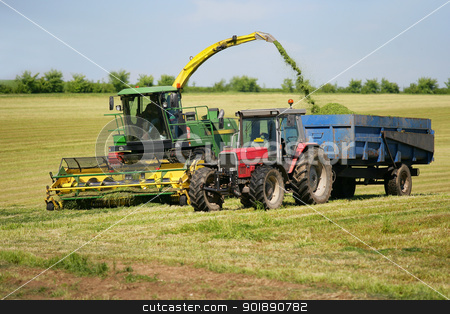 Farm vehicle cutting grass stock photo, Farm vehicle cutting grass by photography33