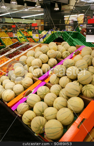 Melons in the supermarket stock photo, Melons in the supermarket by photography33