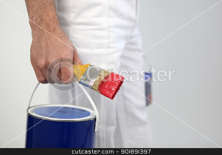 Decorator holding paint and paint brush stock photo, Decorator holding paint and paint brush by photography33