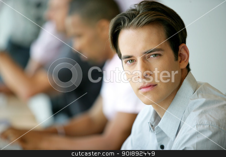 Handsome young man in an office environment stock photo, Handsome young man in an office environment by photography33