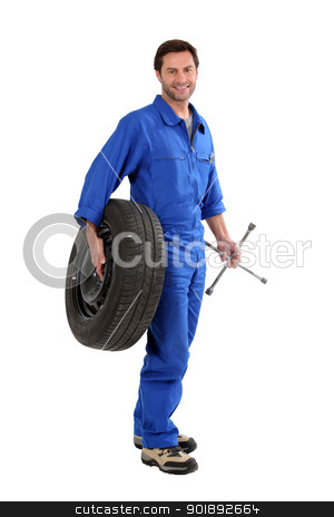 mechanic holding a tire stock photo, mechanic holding a tire by photography33