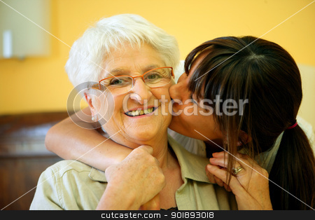Portrait of a young woman kissing a smiling senior woman on the cheek stock photo, Portrait of a young woman kissing a smiling senior woman on the cheek by photography33