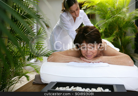 Woman enjoying a back massage stock photo, Woman enjoying a back massage by photography33