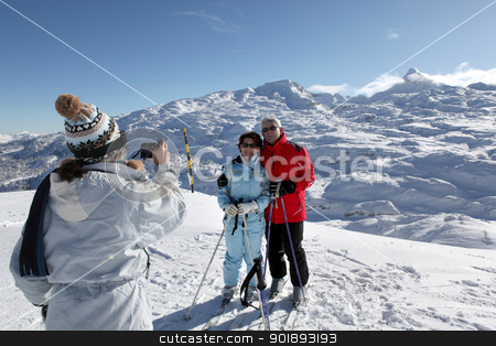 Skiers posing with the mountain landscape stock photo, Skiers posing with the mountain landscape by photography33