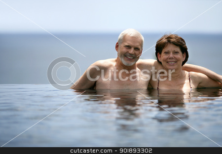 Adult couple in swimming pool stock photo, Adult couple in swimming pool by photography33