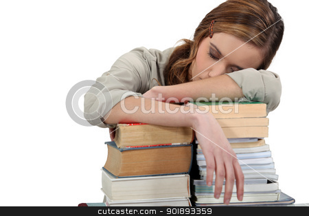 Female student asleep on her books stock photo, Female student asleep on her books by photography33
