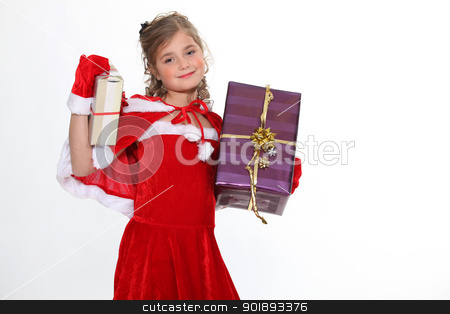 Girl in a Santa costume bearing gifts stock photo, Girl in a Santa costume bearing gifts by photography33