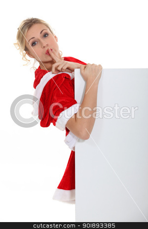 Woman with her finger on her lips stock photo, Woman with her finger on her lips by photography33