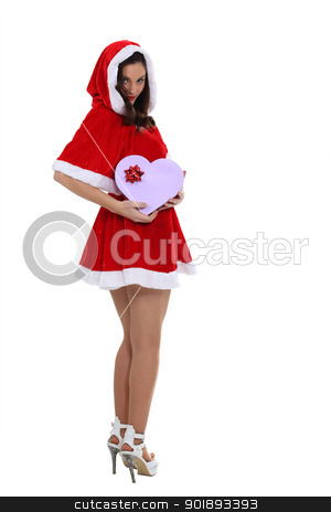 Saucy Miss Santa with a heart shaped giftbox stock photo, Saucy Miss Santa with a heart shaped giftbox by photography33