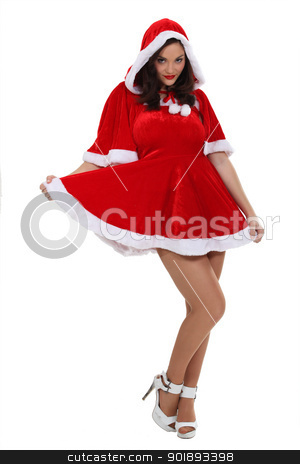 Woman dressed in a sexy Mrs. Claus costume stock photo, Woman dressed in a sexy Mrs. Claus costume by photography33