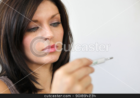 Woman measuring her temperature stock photo, Woman measuring her temperature by photography33