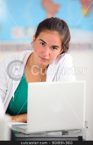 Female teenager alone in class room stock photo, Female teenager alone in class room by photography33