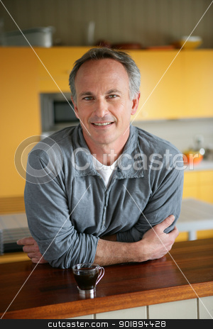 Man in the kitchen with espresso stock photo, Man in the kitchen with espresso by photography33