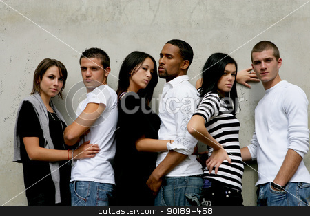 Trendy young people gathered by wall stock photo, Trendy young people gathered by wall by photography33