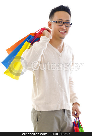 Man shopper stock photo, Happy Asian man shopper holding shopping bag over white background by szefei