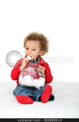 Young girl eating candies stock photo, Young girl eating candies by photography33