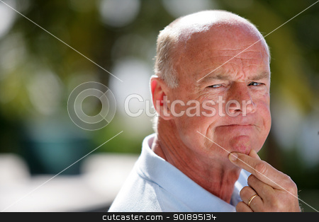 senior man holding his chin stock photo, senior man holding his chin by photography33