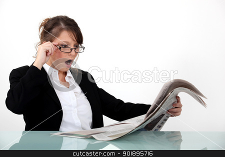 Businesswoman shocked at her newspaper stock photo, Businesswoman shocked at her newspaper by photography33