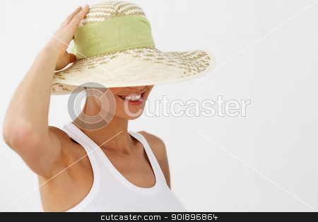 Smiling woman wearing straw hat stock photo, Smiling woman wearing straw hat by photography33