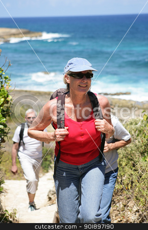 Woman hiking by the seaside stock photo, Woman hiking by the seaside by photography33