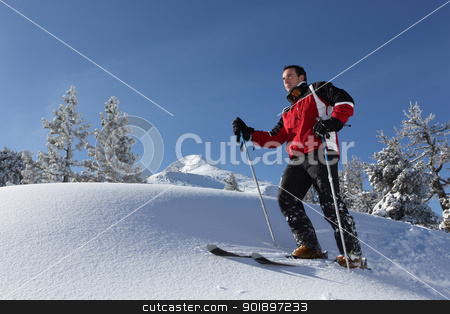 Man skiing on a sunny day stock photo, Man skiing on a sunny day by photography33