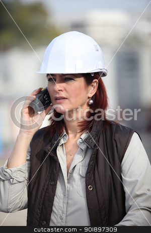 middleaged female architect making a call in construction site stock photo, middleaged female architect making a call in construction site by photography33
