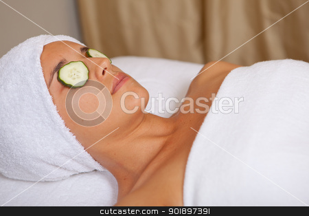 woman relaxing stock photo, woman rexaxing at spa with refreshing cucumber slices on eyes by mandygodbehear