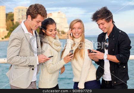 young people phones stock photo, young people or couples with cell or mobile phones  by mandygodbehear