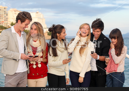 teens with mobile or cell phones stock photo, group of happy smiling teens, kids, texting and calling with mobile or cell phones. by mandygodbehear