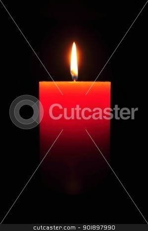 Candle stock photo, Burning large orange candle on a black background by Ondrej Vladyka