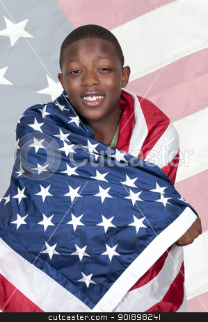 Man with Flag stock photo, Handsome young teenaged black with the American flag by Robert Byron