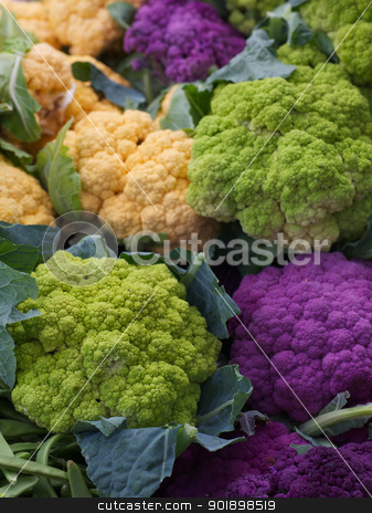 Purple Green Orange Cauliflower stock photo, Pile of Purple Green Orange Cauliflower at the farmers market by bobkeenan