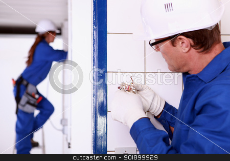 Electrician installing a wall socket stock photo, Electrician installing a wall socket by photography33