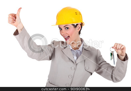 Female architect holding keys stock photo, Female architect holding keys by photography33